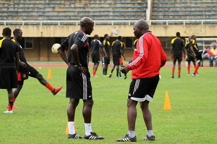 Uganda cranes coach Moses Basena and ex-captain Ibrahim Sekagya talking tactics during training at Namboole.