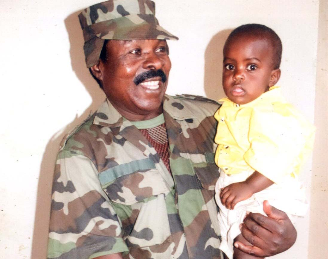 Sgt Kifulugunyu with one of his children. Courtesy photo.