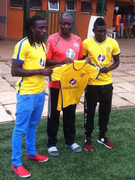 Allan Katerega(left) and Muhammed Shaban(right) with KCCA FC coach Mike Mutebi at their unvailing on Thursday
