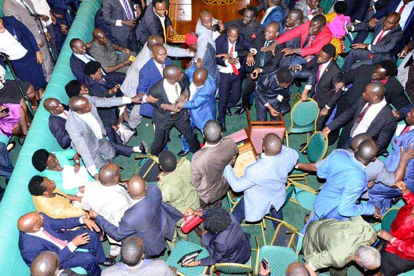 MPs enganged in a fist fight.