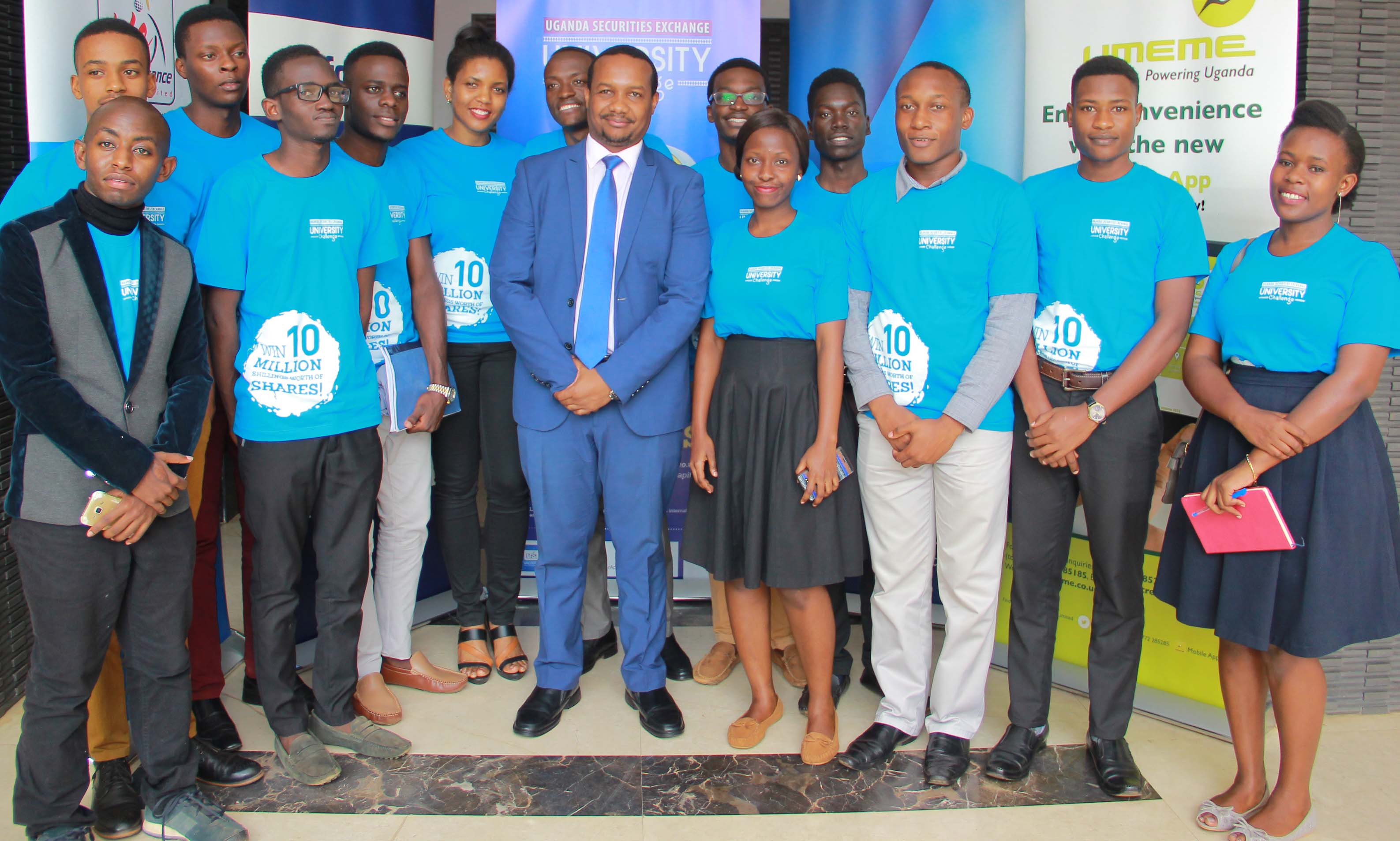 Paul Bwiso (R) CEO Uganda Securities Exchange poses with students during the launch of the USE University Challenge.
