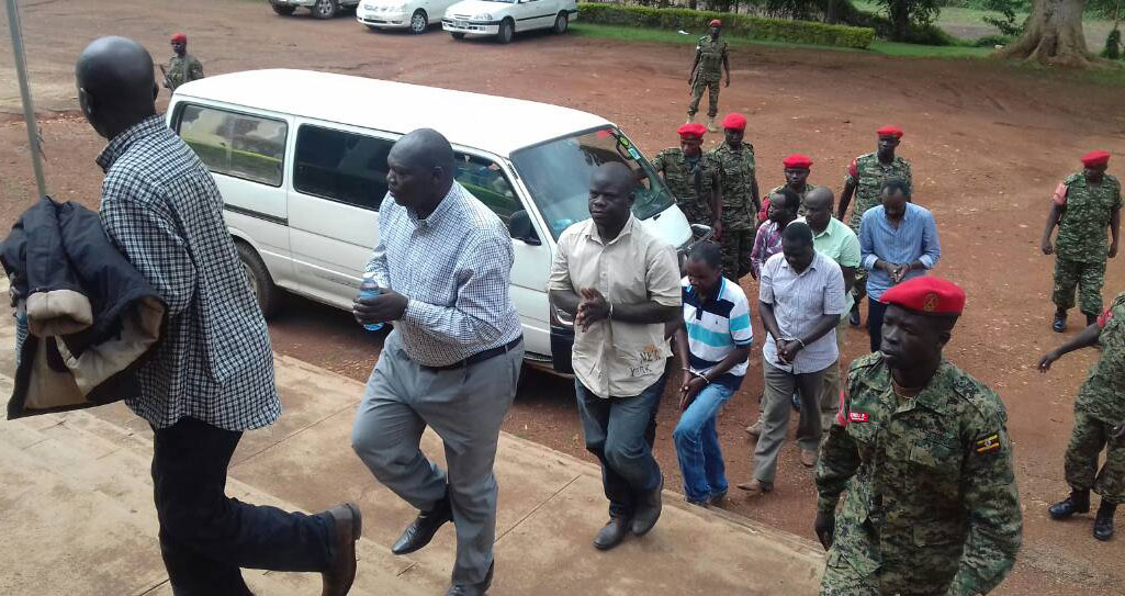 Nine people including five police officers arrested by the Chieftancy of Military Intelligence (CMI), which is also hunting three others in a crackdown that could shake the top ranks in the police hierarchy have arrived at Military Court where they are to be charged over espionage