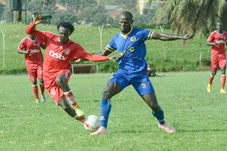 Express midfielder Michael Birungi (left) battles for the ball with URA's defender Richard Kasagga(right) at Wankulukuku
