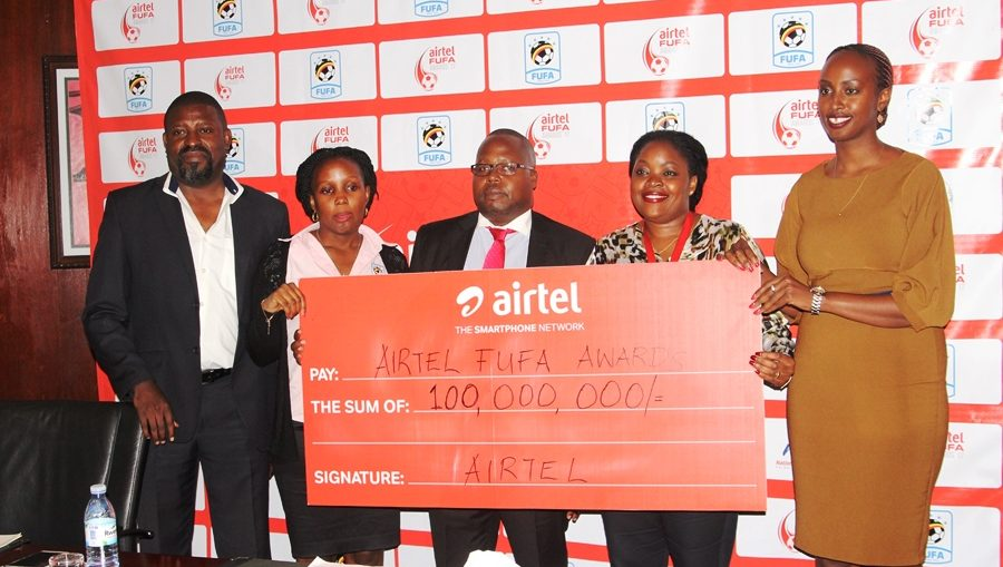 Dennis Mbidde(left) the chairperson FUFA Awards organising committee, Esther Musoke(second left) the FUFA marketing manager, Rogers Byamukama(center), Remy kisakye(second right) at the launch of the awards.