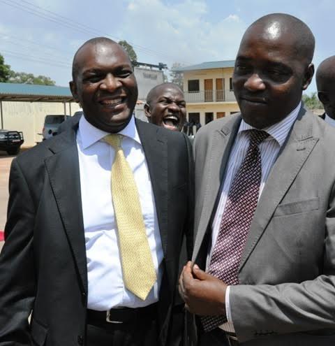 Jinja mayor Magidu Batambuze shares a light moment with former mayor Baswale Kezaala. Photo by Paul Ibanda.