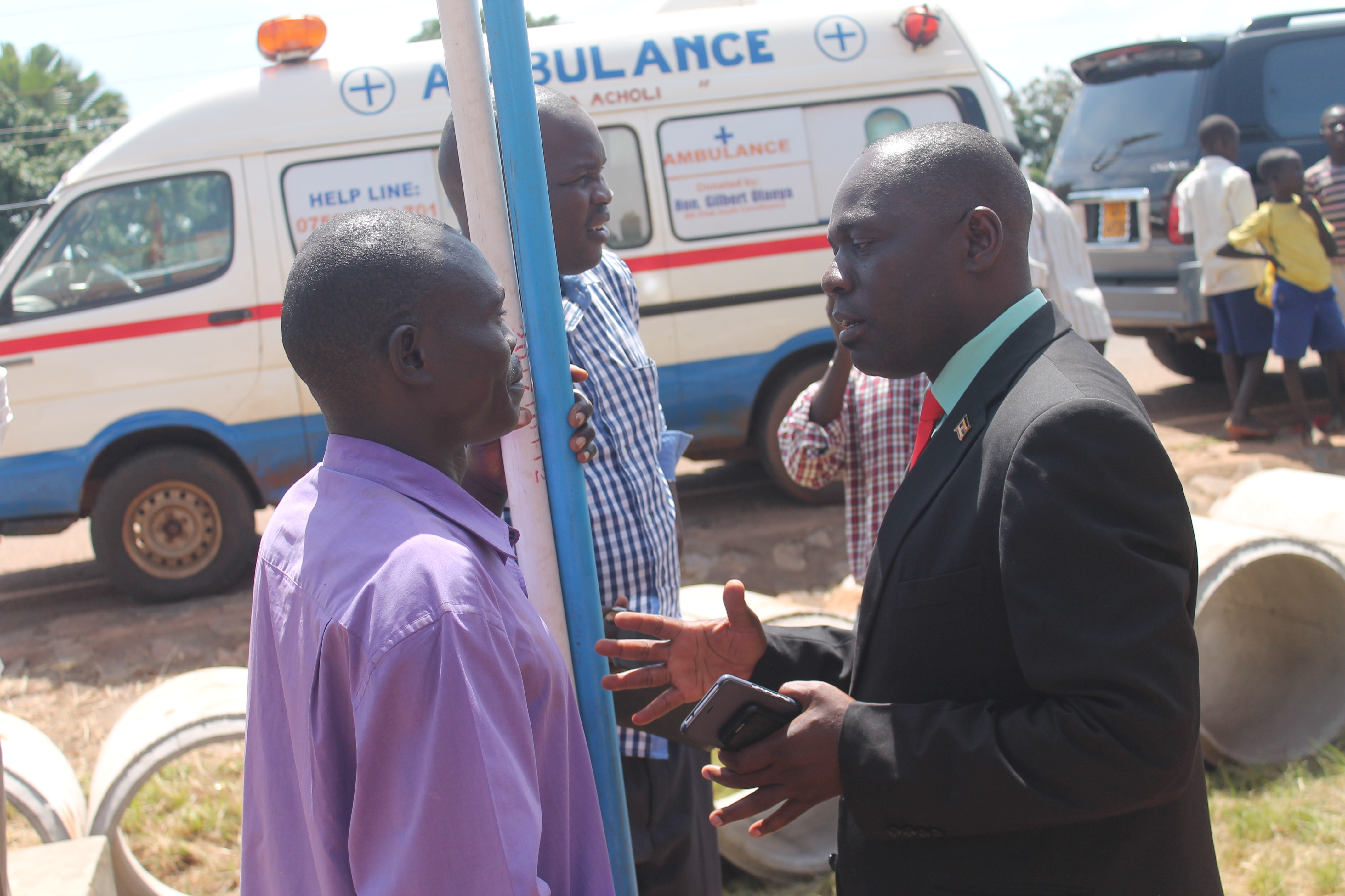 MP Olanya, instructs borehole mechanic at his Constituency ofiice in Lacor Akurukwe, Amuru district today