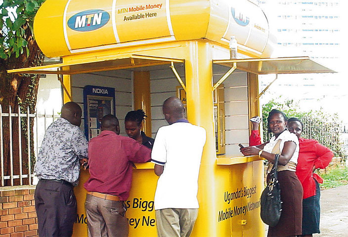 Mobile Money users access services from an outlet (PHOTO/File)