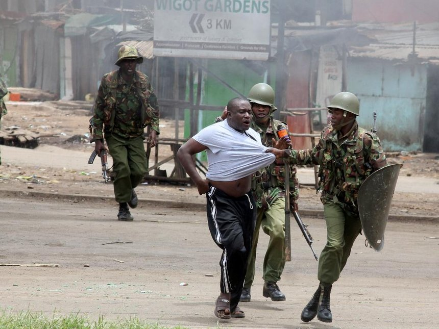 Anti-riot police officers detain a NASA supporter during a demonstration in Kisumu, Kenya.