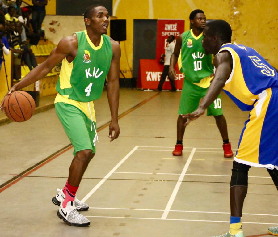 KIU's Sudi Ulanga (left) tries to get past Oilers captain Jimmy Enabu in last nights encounter.