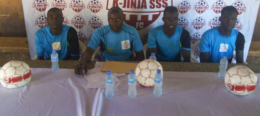 Charles Ayieko(second left) with some of his players at the press briefing ahead of the Proline