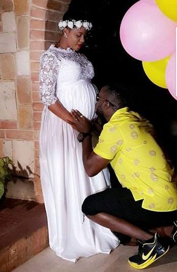 Babe Cool kisses wife Zuena Kirema's belly. Courtesy photo.