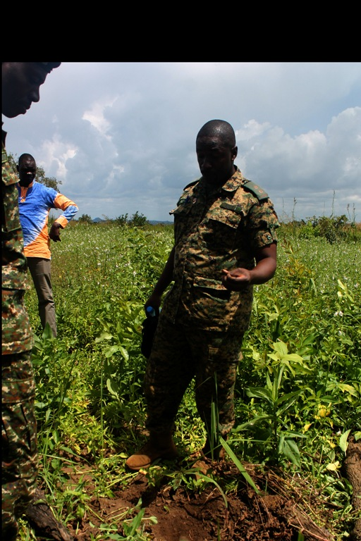 Lieutenant Agaba teaches UXOs focal person before detonating bomb in the village of Omel, in Gulu district.