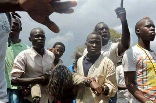 Good Sammaritans carry the body of Olivia Basemera who drowned in Nakivubo channel in August. File photo.