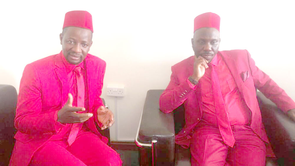 Chief Opposition whip Semujju Nganda (L) and Kawempe North MP Latif Sebaggala (R) both decked in Red as they made a first appearence in parliament today following their boycott of house business.