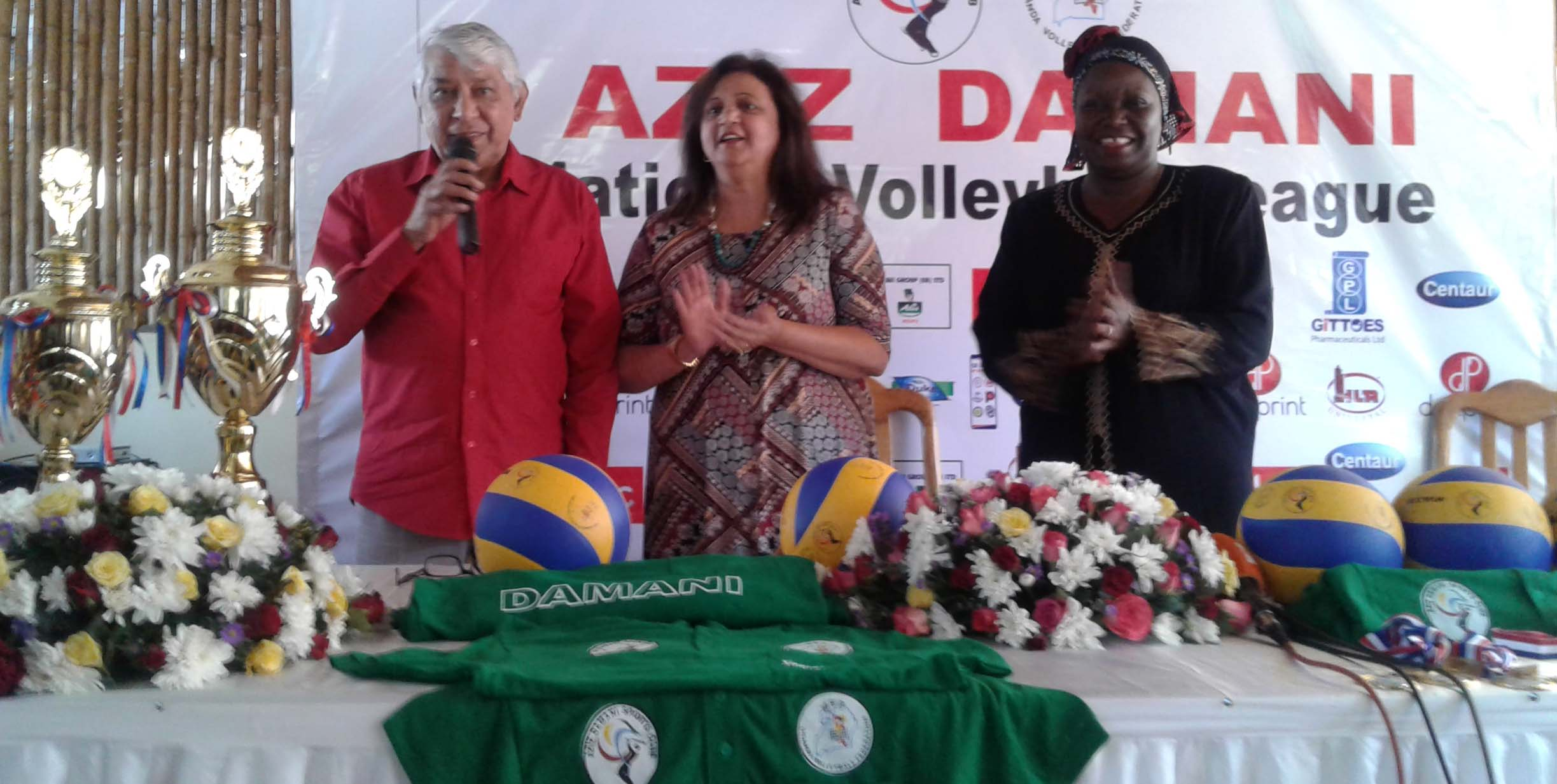 Aziz Damani(right) speaking at the event with us wife Shaniz Damani (center) and Uganda Volleyball Federation president Hadija Namanda.
