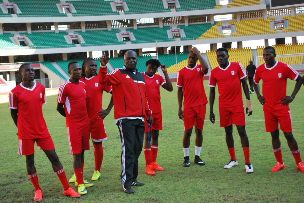 Moses Basena (center) conducting the last training before the Congo Brazzaville game