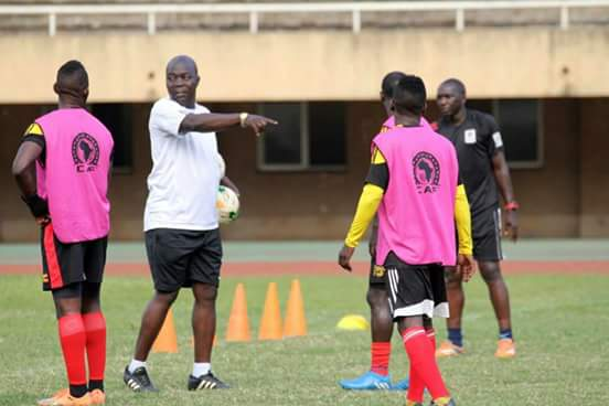 Uganda Cranes head coach Moses Basena (in white) is confident Uganda can go all the way at CHAN 2018