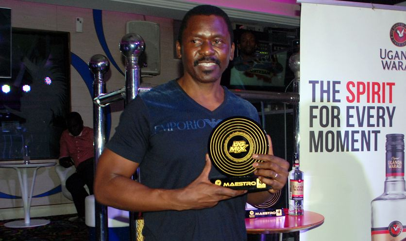Charlie Lubega displays his award.