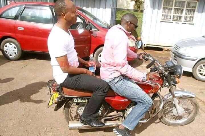 Frank Gashumba rides on a motorcycle soon after being released on bail. Courtesy photo.