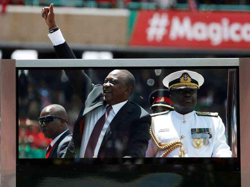 President Uhuru Kenyatta gestures upon his arrival to his inauguration at Kasarani Stadium in Nairobi, November 28, 2017
