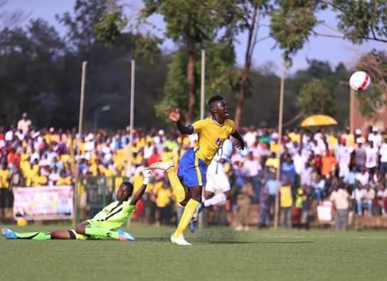 Shaban Muhammad skips Police goalie Davis Mutebi on route to scoring his debut goal. Courtesy photo.