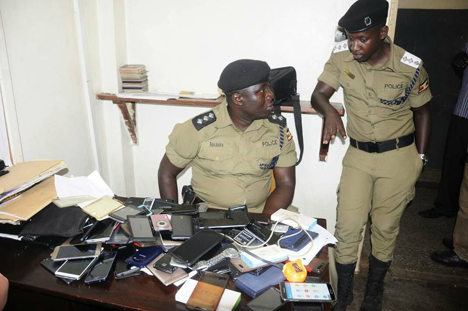 Police officers display some of the recovered phones. Courtesy photo.
