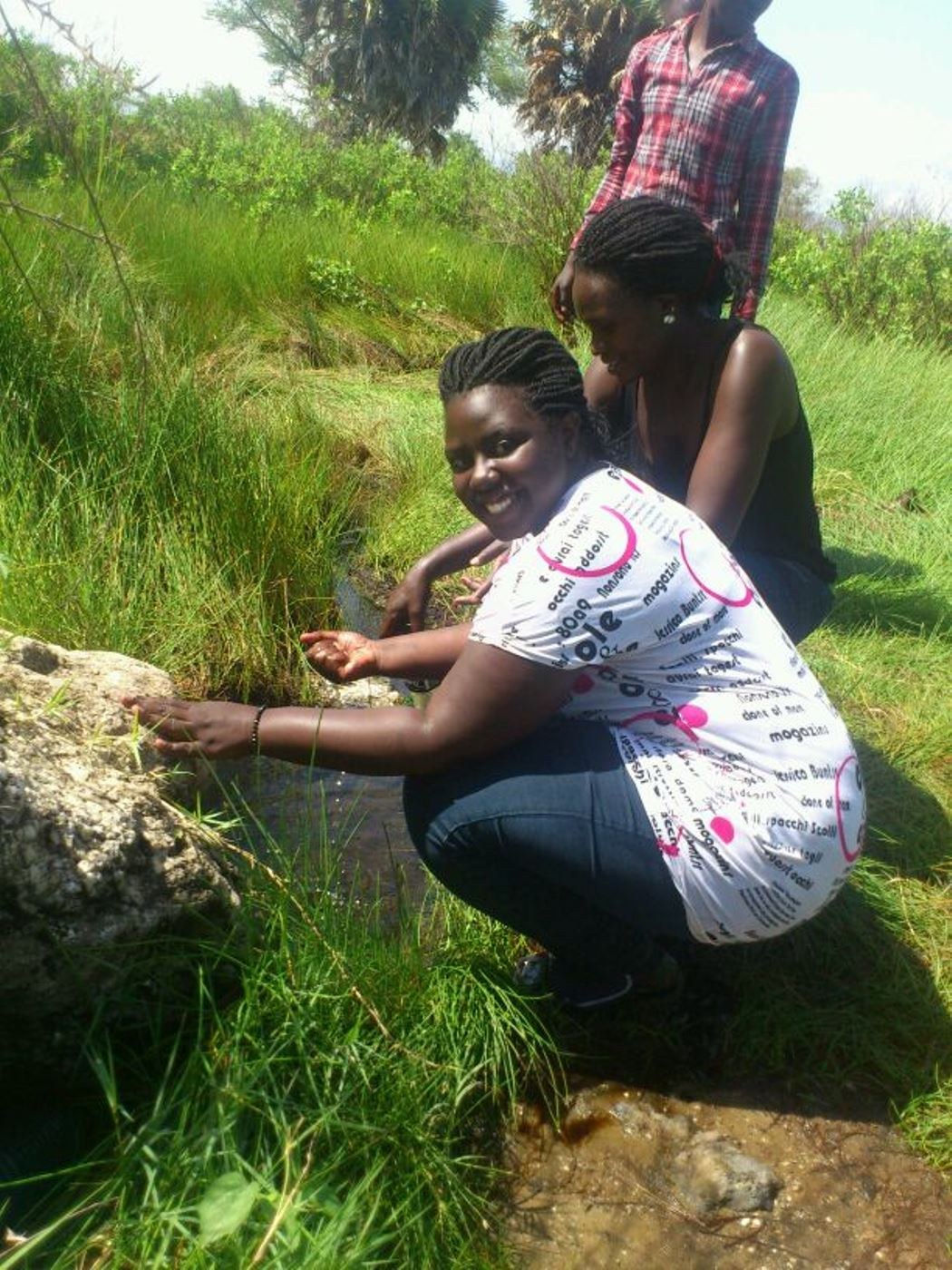 Tourists get the feel of Kanangarok hot springs in Kidepo valley national park. Daudi Nana