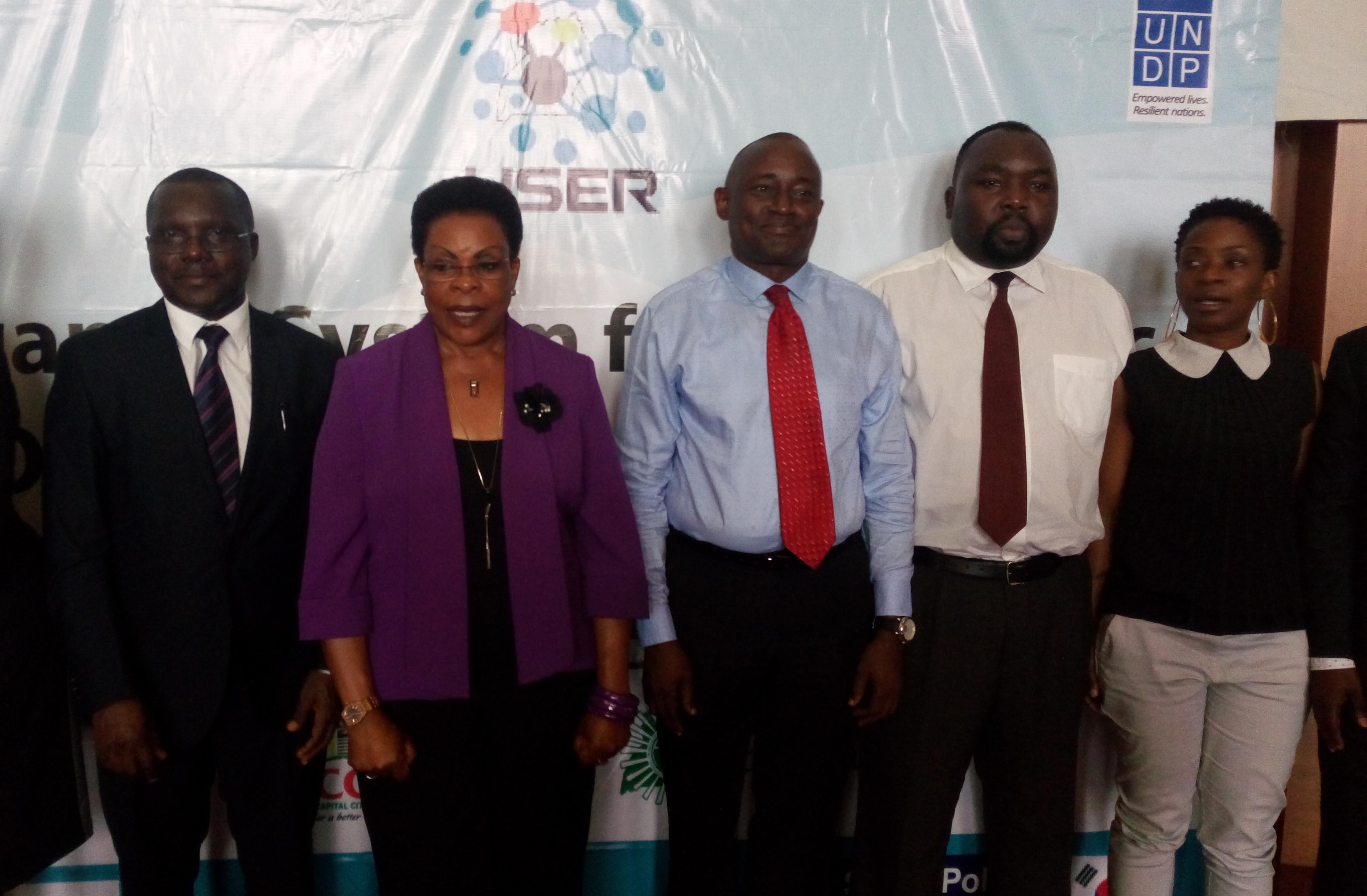 L-R Sam Serunkuuma - deputy Executive Director KCCA, Beti Kamya - Minister for Kampala, Thomas Ole-kuyan - Deputy country director UNDP. Extreme right is Cissy Kagaba Executive Director ACCU