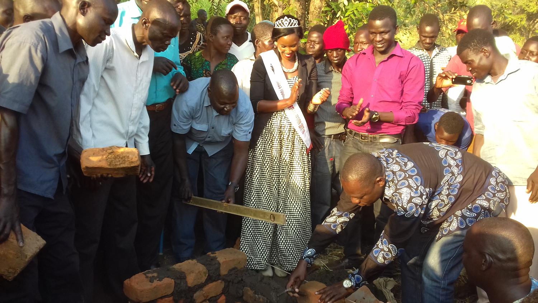 MP Gilbert Olanya lays foundation brick at Guru Guru Hill. Allele cheers the new beginning
