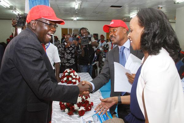 FDC president Patrick Amuriat greets Gen Mugisha Muntu recently. File photo.