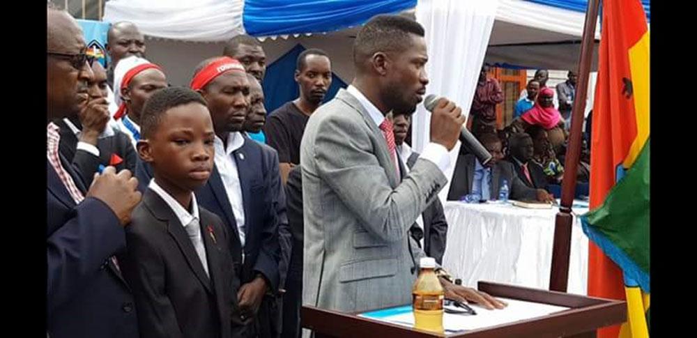 Bobi Wine speaks at the swaering in ceremony for the new FDC president Patrick Oboi Amuriat.