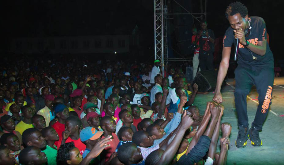 Mun-G performs on stage during the HIV/AIDS awareness concert in Mbarara.
