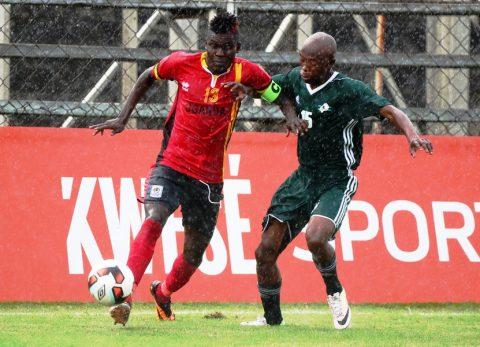 Hippos captain, Shaban Muhammad battling with Lesotho defender Monaheng Rama