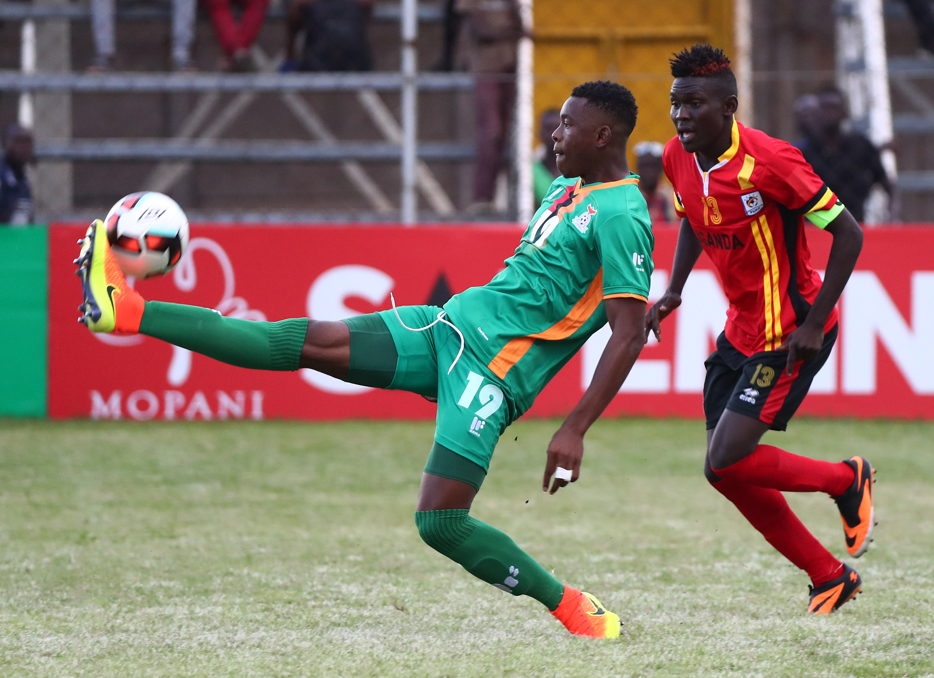 Shaban Muhammad(right) battling for the ball with Zambian defender Ngosa Sunzu yesterday in a game he scored a brace to cap his debut.