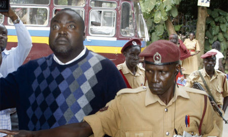 Former NSSF boss David Chandi Jamwa is escortedat the Anti-Corruption Court officers