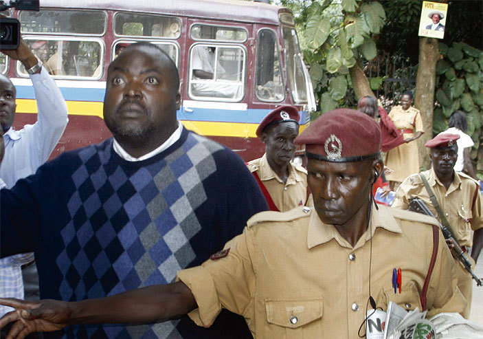 Former NSSF boss David Chandi Jamwa is escortedat the Anti-Corruption Court officers