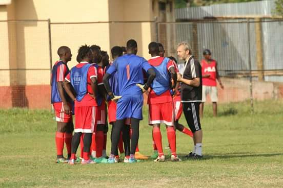 Uganda Cranes head coach Sebastian Desabre (left) with the players before the team travelled. The French man belives the build up games will ne pivotal for the teams' preparations.