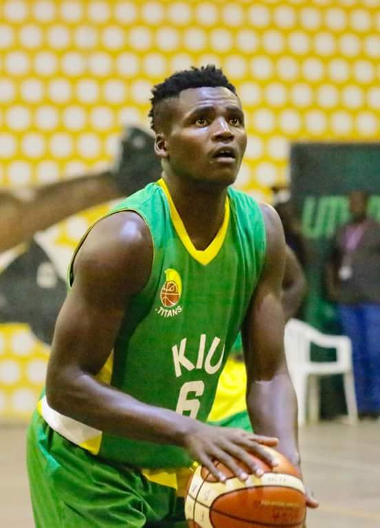 KIU's David Balungu trys to convert a free throw last night as his side lost a third conservative game to City Oilers in the Men's finals.