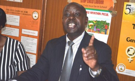 Uganda National Teacher's Union chairperson James Tweheyo addresses journalists at his offices recently: Net Photo