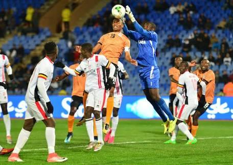 Uganda's goalkeeper Benjamin Ochan collects a cross yesterday against Zambia.