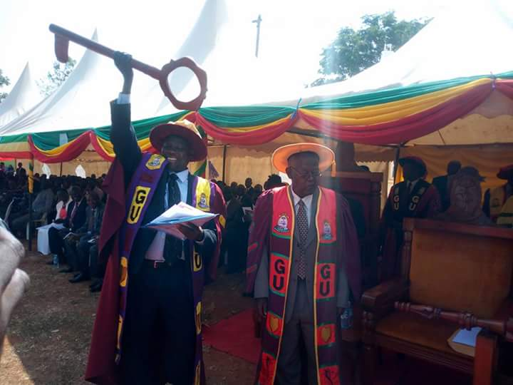 Prof.Openy-juru lifted instrument of power handed by Gulu University Chancellor Prof. Frederick Kayanja at main Campus Friday 13th