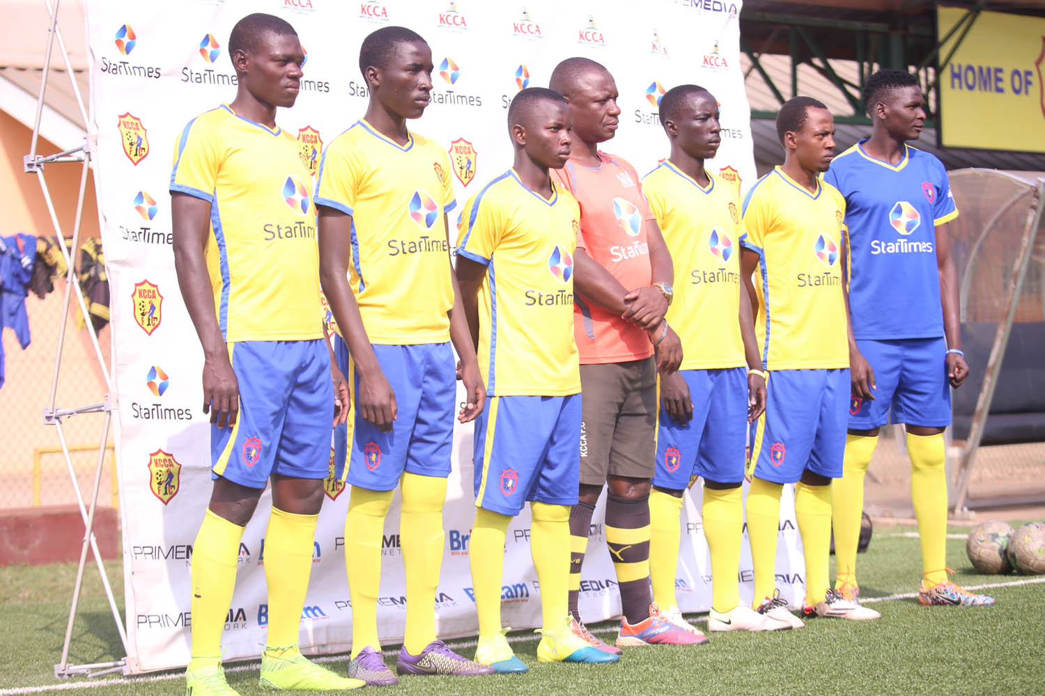 Mike Mutebi (center) with the players he has signed for the club this January.