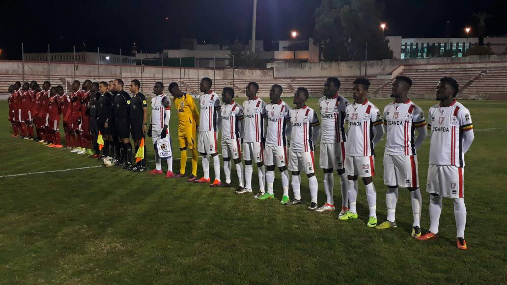 Cranes  (right) and Congo lining up before last night's game.