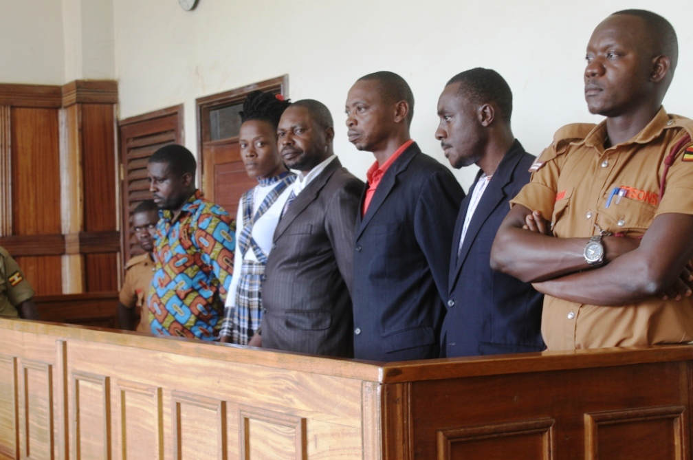 Mr Umar Asiimwe(2ndR) and co-accused appear in court on Tuesday.