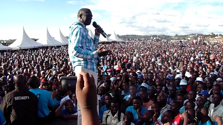Former FDC presidential candidate Kizza Besigye addresses supporters at a campaign rally in 2016
