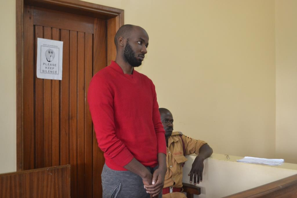 Mr Godfrey Wamala alias Troy listens to the charges being in court on Tuesday: PHOTO BY GEORGE OKELLO