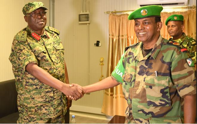Lt Gen. Owoyesigire receives new office as Commander of AMISOM from  Lt. Gen. Osman Noor Soubagleh