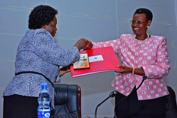 Education minister Janet Museveni receives previous results from UNEB chairperson Mary Okwal (PHOTO/File)