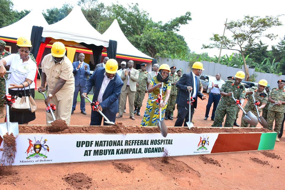 Officials at the groundbreaking ceremony for the UPDF National Refferal Hospital in Muya recently. Part of the army land at the barracks is being claimed by individuals.