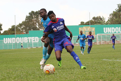 Pic. Viper's Milton Karisa (right) scored his side's first goal as the Venoms over came Police 3-1 in the Uganda Cup.